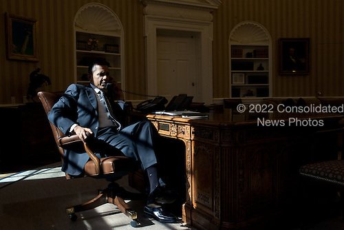 United States President Barack Obama talks on the phone with British Prime Minister David Cameron in the Oval Office, February 13, 2012.  .Mandatory Credit: Pete Souza - White House via CNP