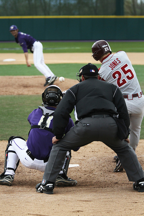 Derek Jones (#25), Washington State sophomore outfielder, is about to connect with a pitch during the Cougars Pac-10 conference victory over arch-rival Washington on the road in Seattle, Washington, on April 3, 2010.