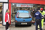 The scene of destruction in Drogheda after the driver of the opel cora car drive it through the front window of Victor Dwyer stop in Shop Street, Climbed out of the car and had to run through the shop to escape, he was later picked up nearly a mile away from the scene after a passer by followed him on his escape. the accident happened on the main pedestrian walk way in the town, nobody was injured in the accident..Photo: Fran Caffrey/www.newsfile.ie...
