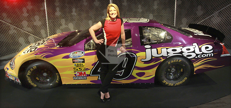 CrowdSource CEO Stephanie Leffler stands next to the NASCAR race car that is in the main work area of the Swansea-based content and search enine optimization business.  Their coporate owner - Juggle.com - sponsored the racing team and now the car resides in their office.  CrowdSource recently bought out one of their top competitors, San Francisco-based Servio.