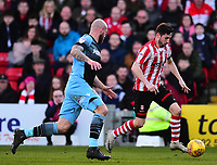 Lincoln City's Tom Pett looks to get past Stevenage's Scott Cuthbert<br /> <br /> Photographer Andrew Vaughan/CameraSport<br /> <br /> The EFL Sky Bet League Two - Lincoln City v Stevenage - Saturday 16th February 2019 - Sincil Bank - Lincoln<br /> <br /> World Copyright © 2019 CameraSport. All rights reserved. 43 Linden Ave. Countesthorpe. Leicester. England. LE8 5PG - Tel: +44 (0) 116 277 4147 - admin@camerasport.com - www.camerasport.com