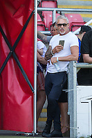 Wayne Lineker waits by the tunnel to get some photos on his phone during the 'Greatest Show on Turf' Celebrity Event - Once in a Blue Moon Events at the London Borough of Barking and Dagenham Stadium, London, England on 8 May 2016. Photo by Andy Rowland.