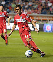 Chicago defender Gonzalo Segares (13) dribbles away from pressure.  The Portland Timbers defeated the Chicago Fire 1-0 at Toyota Park in Bridgeview, IL on July 16, 2011.