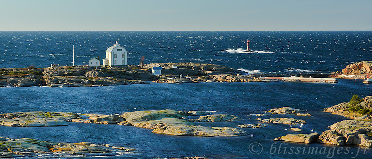 Old Kobba Klintar pilot station and Marhällan lighthouse, Åland, Finland on windy November day -panorama.