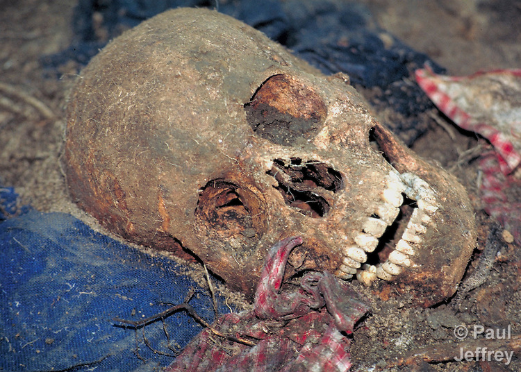 The skull of a man murdered in July 1982 by Guatemalan soldiers as they swept through the Maya highland village of Tabil. Eighteen people in the village were assassinated by the U.S.-backed soldiers and buried in two mass graves. In 1997, the Catholic Church helped the villagers exhume the bodies, identify the remains, and rebury them properly.