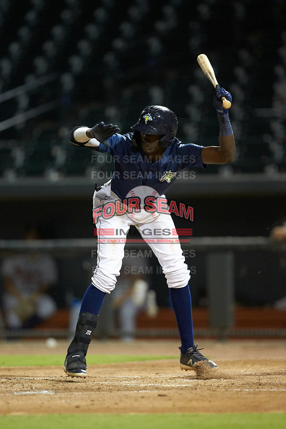 Ronny Mauricio (2) of the Columbia Fireflies avoids an inside pitch against the Rome Braves at Segra Park on May 13, 2019 in Columbia, South Carolina. The Fireflies defeated the Braves 6-1 in game two of a doubleheader. (Brian Westerholt/Four Seam Images)