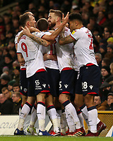 Bolton Wanderers' Mark Beevers is mobbed after scoring his side's equalising goal to make the score 2-2<br /> <br /> Photographer David Shipman/CameraSport<br /> <br /> The EFL Sky Bet Championship - Norwich City v Bolton Wanderers - Saturday 8th December 2018 - Carrow Road - Norwich<br /> <br /> World Copyright &copy; 2018 CameraSport. All rights reserved. 43 Linden Ave. Countesthorpe. Leicester. England. LE8 5PG - Tel: +44 (0) 116 277 4147 - admin@camerasport.com - www.camerasport.com
