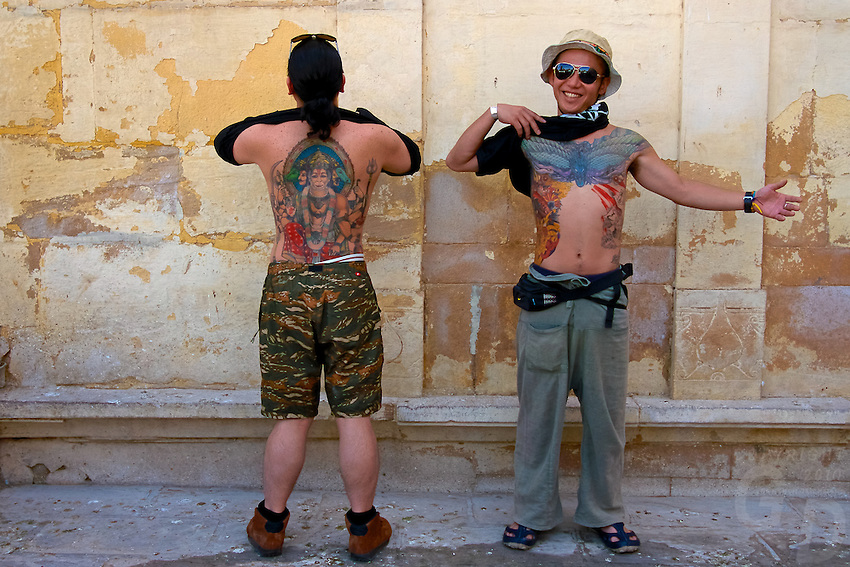 Japanese Tourist showing off their tattoos in Bikaner, Rajasthan India