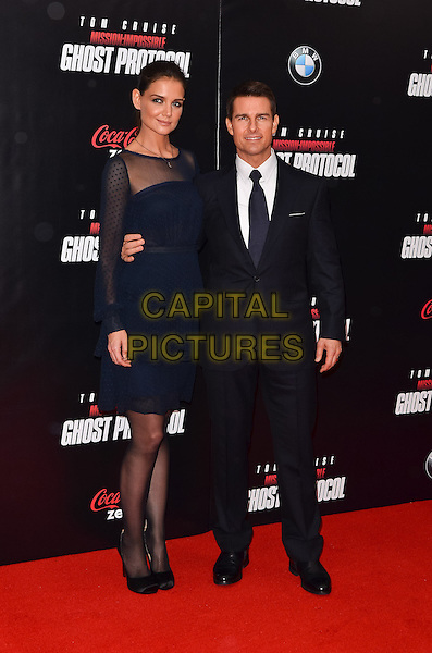 "29 June 2012 - Los Angeles, CA - After five years of marriage, Tom Cruise and Katie Holmes are getting a divorce. Katie Holmes initiated the divorce filing. File Photo: 19 December 2011 - New York City, NY - Katie Holmes, Tom Cruise. ""Mission: Impossible - Ghost Protocol"" New York Premiere..full length  sheer blue dress polka dot suit tie black  ruffles .CAP/ADM/CS.©Christopher Smith/AdMedia/Capital Pictures."