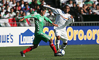 Carlos Esquivel (16) and Armando Collado (4) battle for the ball. Mexico defeated Nicaragua 2-0 during the First Round of the 2009 CONCACAF Gold Cup at the Oakland, Coliseum in Oakland, California on July 5, 2009.