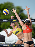 ST. PETERSBURG, FL - JUNE 18: Louise Bawden of Australia spikes the ball against Lauren Fendrick of the USA during the FIVB Beach Volleyball World Tour St. Petersburg Grand Slam presented by the AVP on June 18, 2015 at Spa Beach in St. Petersburg, Florida. (Photo by Donald Miralle for the AVP)