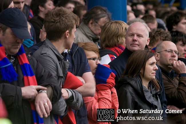 Crystal Palace fans watching the action nervously at Hillsborough during their team's crucial last-day relegation match against Sheffield Wednesday. The match ended in a 2-2 draw which meant Wednesday were relegated to League 1. Crystal Palace remained in the Championship despite having been deducted 10 points for entering administration during the season.