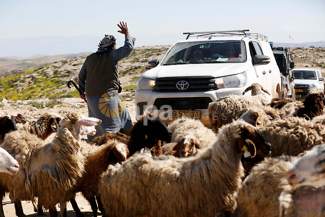 A Palestinian man argues with Israeli security forces as they secure Israeli bulldozers demolishing water network on a Palestinian land near the village of Yatta, south of the West Bank city of Hebron, February 13, 2019. Israeli authorities regularly demolish constructions and makeshift infrastructure of Palestinian residents who do not have needed permits to build or establish infrastructure in area C which is under the Israeli control in the occupied West Bank. Photo by Wisam Hashlamoun
