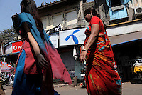 Women walk past advertising for Uninor on a street in Mumbai. Telenor warned it could be forced to reconsider its presence in India if the New Delhi revises the terms of its spectrum licence amid a political scandal over regulation of the Indian telecoms industry.<br /> <br /> Unitech, since renamed Uninor, is one of five companies alleged to have benefited from irregularities that an official audit claimed had cost the Indian government $39bn in lost revenues from spectrum licenses. <br /> <br /> Further reading : http://www.ft.com/cms/s/0/f391ebb0-33b4-11e0-b1ed-00144feabdc0.html#axzz1DWW1eUZh