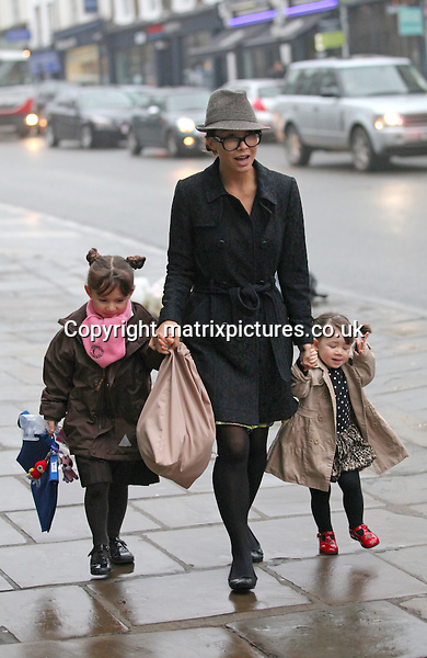 NON EXCLUSIVE PICTURE: MATRIXPICTURES.CO.UK.PLEASE CREDIT ALL USES..WORLD RIGHTS..British media personality Myleene Klass is pictured walking in North London with her daughters Ava and Hero...FEBRUARY 26th 2013..REF: WTX 131309