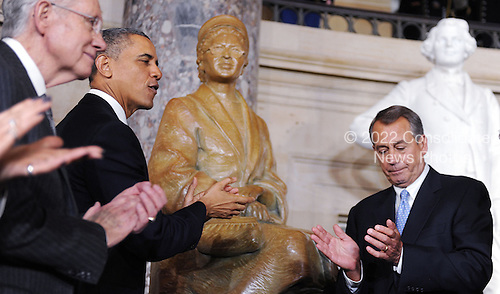 United States President Barack Obama, center, and Speaker of the U.S. House John Boehner (Republican of Ohio), right, and U.S. Senate Majority Leader Harry Reid (Democrat of Nevada), left, look on during the unveiling of a statue of Rosa Parks in Statuary Hall at the United States Capitol, February 27, 2013 in Washington, DC. .Credit: Olivier Douliery / Pool via CNP