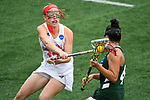 TAMPA, FL - MAY 20: Julia Couch #12 of the Florida Southern Mocs defends Kasi Cabrey #4 of the Le Moyne Dolphins during the Division II Women's Lacrosse Championship held at the Naimoli Family Athletic and Intramural Complex on the University of Tampa campus on May 20, 2018 in Tampa, Florida. Le Moyne defeated Florida Southern 16-11 for the national title. (Photo by Jamie Schwaberow/NCAA Photos via Getty Images)
