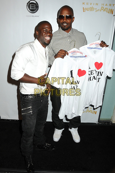 "Kevin Hart and Jamie Foxx.Kevin Hart's ""Laugh At My Pain"" Los Angeles Premiere held at the Pacific Design Center, West Hollywood, California, USA..September 7th, 2011.full length check beige grey gray shirt t-shirt holding sunglasses shades heart love white jeans denim.CAP/ADM/BP.©Byron Purvis/AdMedia/Capital Pictures."