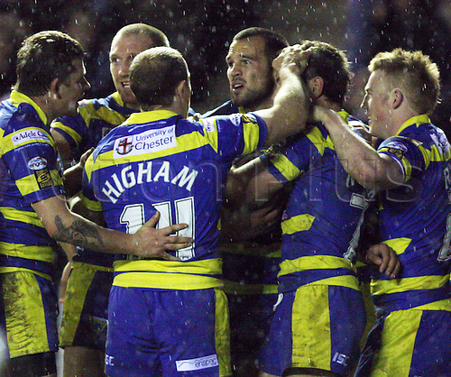25.02.2011 Engage Super League Rugby from the Stobart Stadium, Halton, Widnes. St Helens v Warrington. The Warrington players celebrate scoring a try