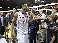 Virginia guard Justin Anderson (23) greets the fans after the game against Clemson Thursday in Charlottesville, VA.