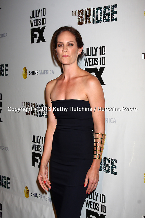 """LOS ANGELES - JUL 8:  Annabeth Gish arrives at """"The Bridge"""" FX Network Premiere Screening at the Directors Guild of America on July 8, 2013 in Los Angeles, CA"""