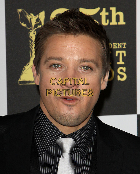 JEREMEY RENNER .25th Annual Film Independent Spirit Awards held At The Nokia LA Live, Los Angeles, California, USA,.March 5th, 2010 ..arrivals Indie Spirit portrait headshot mouth open black  white silver tie funny .CAP/ADM/KB.©Kevan Brooks/Admedia/Capital Pictures
