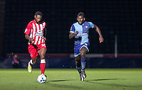Janoi Donacien of Accrington Stanley & Aaron Pierre of Wycombe Wanderers chases down the ball during the Sky Bet League 2 match between Wycombe Wanderers and Accrington Stanley at Adams Park, High Wycombe, England on 16 August 2016. Photo by Andy Rowland.
