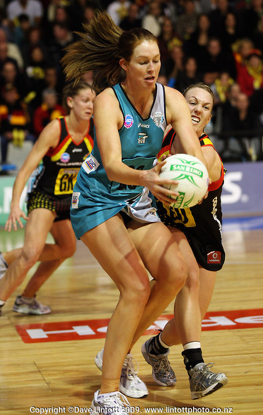 Magic goalshoot Irene Van Dyk catches a pass under pressure from Geva Mentor during the ANZ Netball Championship match between the Waikato Bay of Plenty Magic and Adelaide Thunderbirds, Mystery Creek Events Centre, Hamilton, New Zealand on Sunday 19 July 2009. Photo: Carl Johnstone / lintottphoto.co.nz