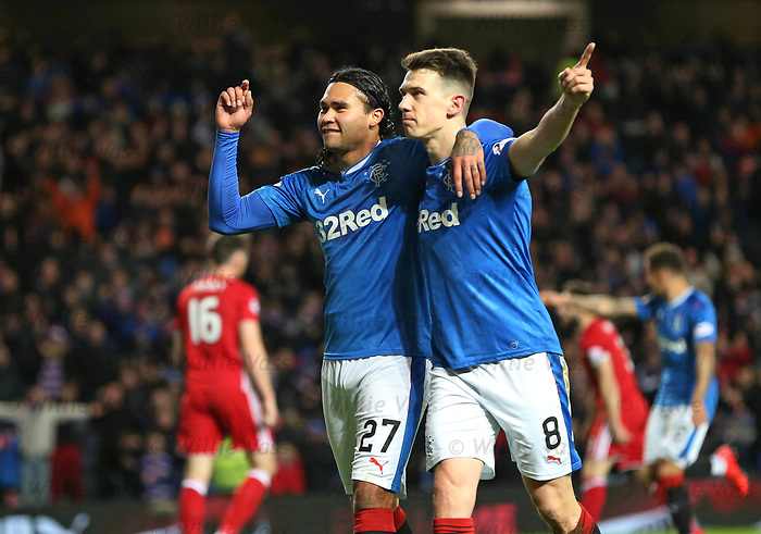 Carlos Peña celebrates his goal with Ryan Jack