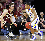 SIOUX FALLS, SD - MARCH 7:  George Marshall #11 of South Dakota State dribbles into defender C.J. Bobbitt #15 of Denver in the 2016 Summit League Tournament.  (Photo by Dick Carlson/Inertia)