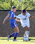 SIOUX FALLS, SD - SEPTEMBER 5: Elisa Martínez #10 from the University of Sioux Falls pushes the ball past Kadie Walaszczyk #15 from Nebraska Kearney in the first half of their game Friday evening in Sioux Falls.  (Photo by Dave Eggen/Inertia)