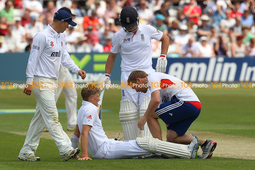 Joe Root of England receives treatment for an injury after being hit by a Tymal Mills delivery - Essex CCC vs England - LV Challenge Match at the Essex County Ground, Chelmsford - 30/06/13 - MANDATORY CREDIT: Gavin Ellis/TGSPHOTO - Self billing applies where appropriate - 0845 094 6026 - contact@tgsphoto.co.uk - NO UNPAID USE