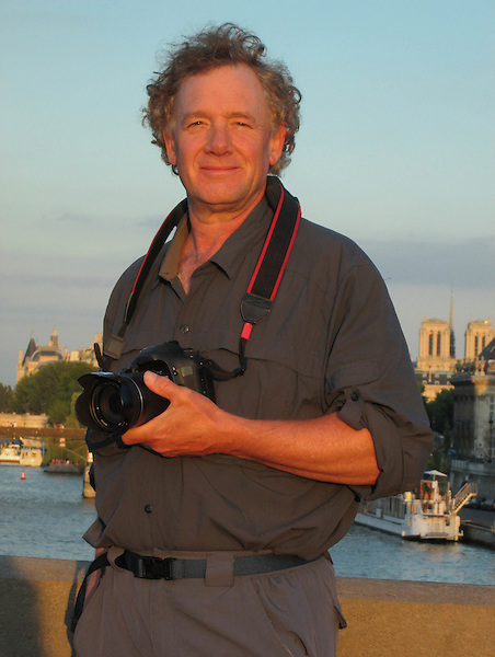 John Kieffer along the Seine River at sunset, Paris, France.
