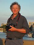 John Kieffer along the Seine River at sunset, Paris, France.