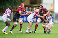 20120823 Copyright onEdition 2012©.Free for editorial use image, please credit: onEdition..Steve Borthwick of Saracens is tackled by Blaise Dumas and Arthur Chollon of Stade Francais Paris at The Honourable Artillery Company, London in the pre-season friendly between Saracens and Stade Francais Paris....For press contacts contact: Sam Feasey at brandRapport on M: +44 (0)7717 757114 E: SFeasey@brand-rapport.com..If you require a higher resolution image or you have any other onEdition photographic enquiries, please contact onEdition on 0845 900 2 900 or email info@onEdition.com.This image is copyright the onEdition 2012©..This image has been supplied by onEdition and must be credited onEdition. The author is asserting his full Moral rights in relation to the publication of this image. Rights for onward transmission of any image or file is not granted or implied. Changing or deleting Copyright information is illegal as specified in the Copyright, Design and Patents Act 1988. If you are in any way unsure of your right to publish this image please contact onEdition on 0845 900 2 900 or email info@onEdition.com
