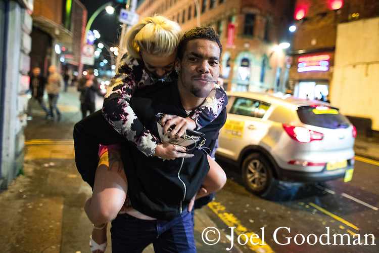 """© Joel Goodman - 07973 332324 . 17/12/2016 . Manchester , UK . Revellers in Manchester City Centre overnight during """" Mad Friday """" , named for being one of the busiest nights of the year for the emergency services in the UK . Photo credit : Joel Goodman"""