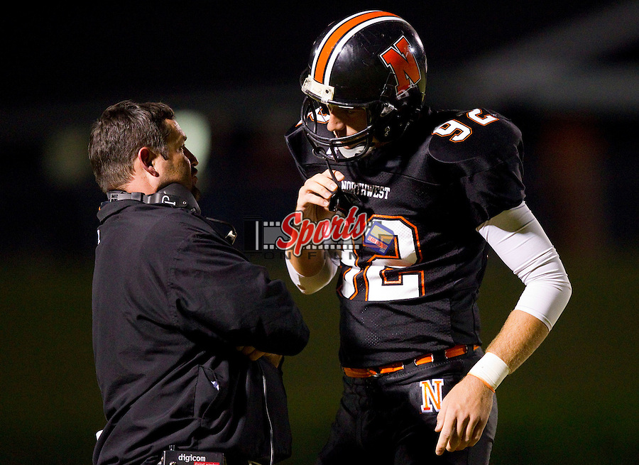 Northwest Cabarrus Trojans head coach Rich Williams talks with kicker Bradley Pinion (92) prior to a field goal attempt at Trojan Stadium September 30, 2011, in Concord, North Carolina.  The Trojans defeated the Bulldogs 37-10.  (Brian Westerholt/Sports On Film)