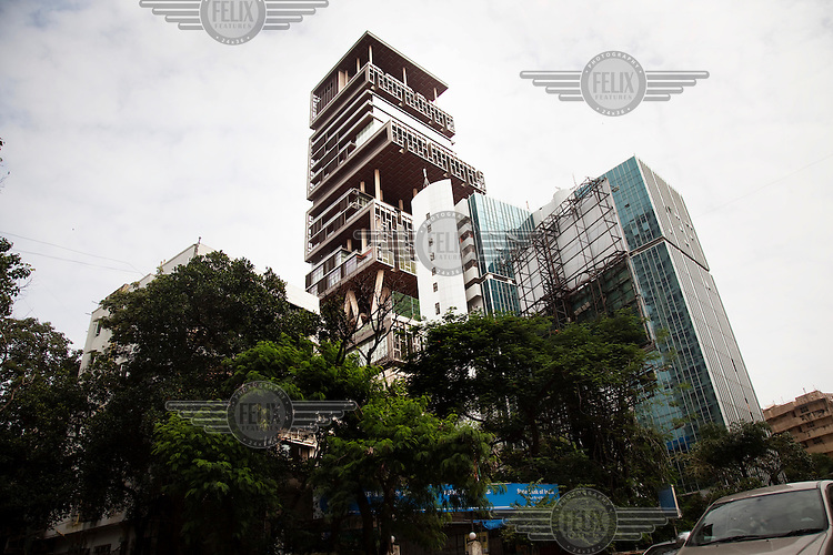 Mukesh Ambani, India's richest man, builds the world's first billion-dollar home. The Mumbai property, named Antilia after a mythical island, is worth GBP630m. According to Forbes magazine, Ambani, who owns much of Reliance Industries, is worth GBP18bn.
