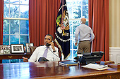 United States Vice President Joe Biden looks out the window as U.S. President Barack Obama talks on the phone with House Speaker John Boehner (Republican of Ohio) in the Oval Office to discuss ongoing efforts in the debt limit and deficit reduction talks, Sunday, July 31, 2011. .Mandatory Credit: Pete Souza - White House via CNP