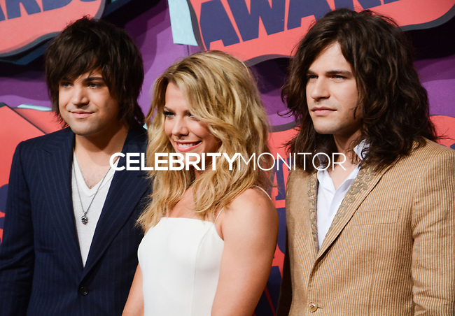NASHVILLE, TN, USA - JUNE 04: Neil Perry, Kimberly Perry, Reid Perry, The Band Perry at the 2014 CMT Music Awards held at the Bridgestone Arena on June 4, 2014 in Nashville, Tennessee, United States. (Photo by Celebrity Monitor)