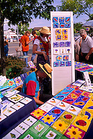 Ganges, Saltspring (Salt Spring) Island, Southern Gulf Islands, BC, British Columbia, Canada - Artist selling Paintings at Saturday Market