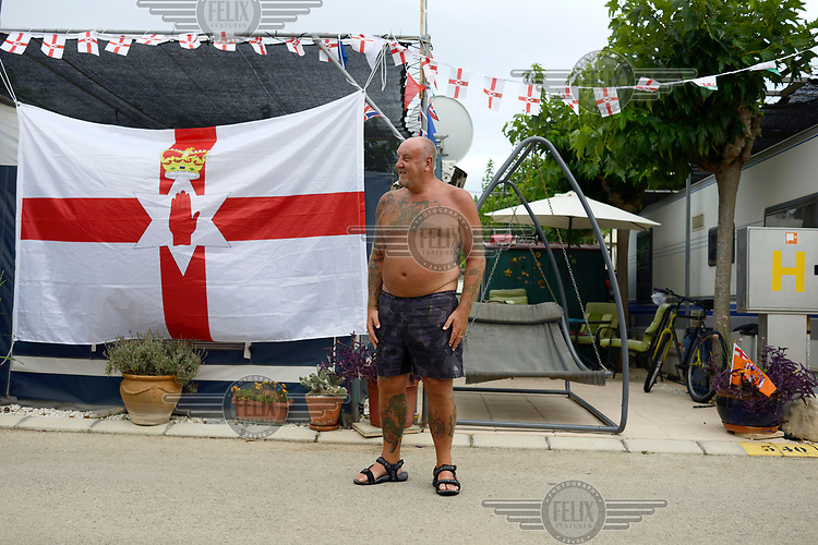 Robert Ballance (58) stands in front of a huge Ulster Banner, the unofficial Protestant Northern Irish flag in front of the mobile home where he lives most of the year on a camp site in Benidorm.  <br /> Benidorm is one of the biggest tourist destinations in Spain and also home to thousands of ex-patriot British citizens. Brexit has left them waiting anxiously to learn their status once the UK leaves the EU.