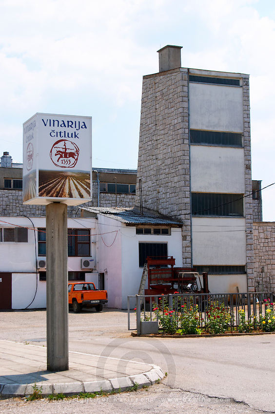 The entrance to the winery, the gate, the main winery building and a sign saying 'Vinarija Citluk 1353'. Vinarija Citluk winery in Citluk near Mostar, part of Hercegovina Vino, Mostar. Federation Bosne i Hercegovine. Bosnia Herzegovina, Europe.