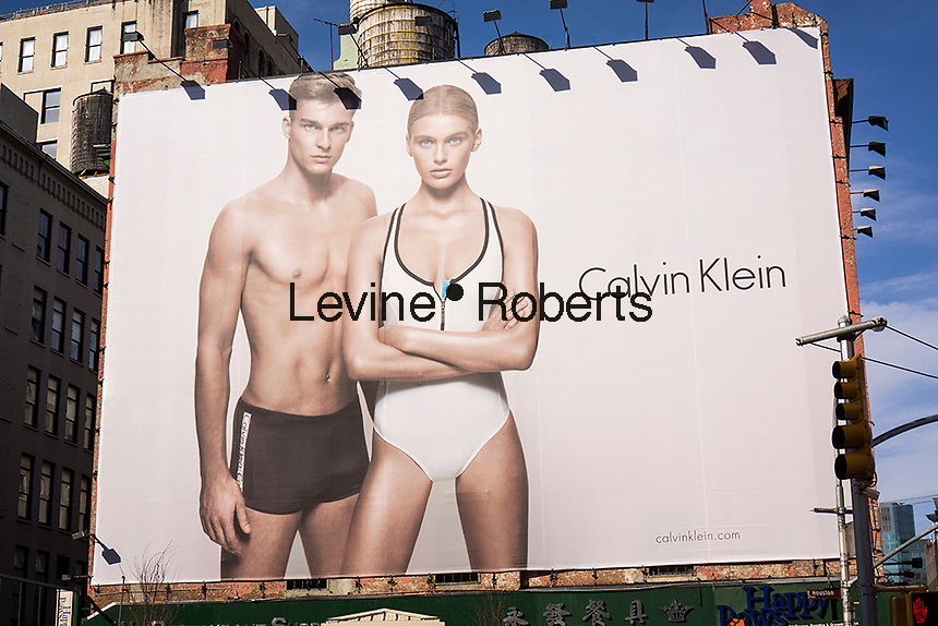 A Calvin Klein billboard advertises his line of swimming suits in the Soho neighborhood of New York on Sunday, April 7, 2013. Klein's advertisements use sex and provocative images to test society's cultural and moral boundaries.  (© Richard B. Levine)