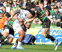 Northampton, England. Manusamoa Tuilagi of Leicester Tigers tackled by Jamie Elliott of Northampton Saints during the Northampton Saints and Leicester Tigers  during the Aviva Premiership match at Franklin's Gardens, Northampton, England on March 29, 2014