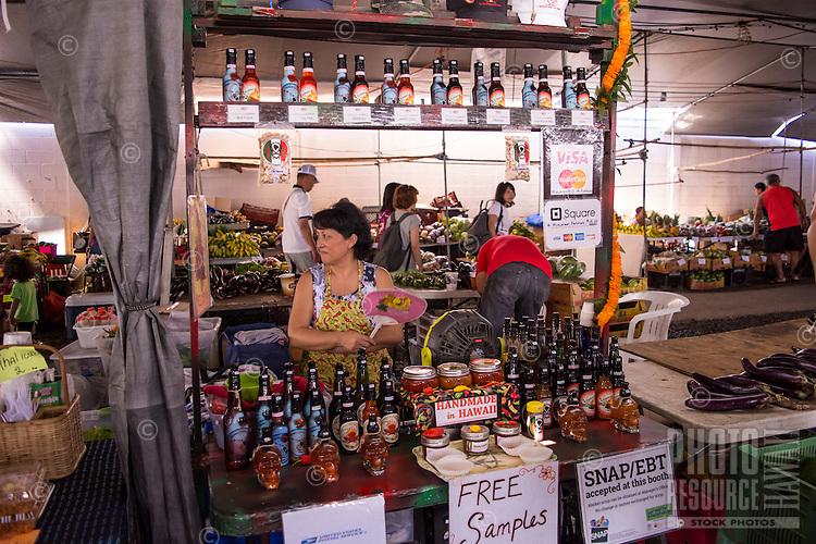 A familiar sight of numerous food vendors at the Hilo Farmers Market on Mamo Street in downtown Hilo, Big Island of Hawai'i.
