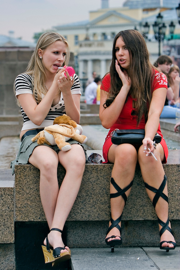 Moscow, Russia, 09/07/2006..Girls adjust their make-up on Manezh Square by the Kremlin.