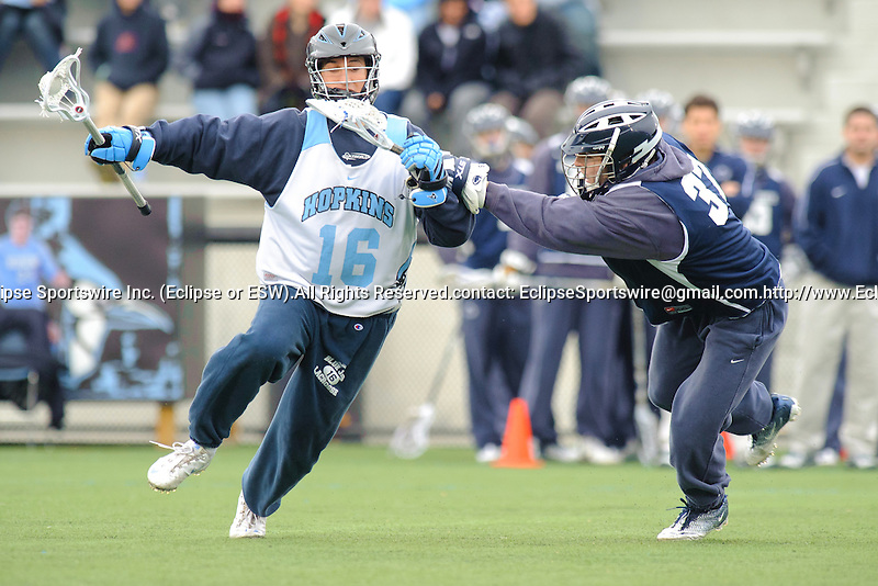 Baltimore- February 4: Mid-Fielder Lee Coppersmith of Hopkins moves past Penn State's Ryne Sternberg during the exhibition between Johns Hopkins and Penn State at Homewood Field on February 04, 2012 in Baltimore, MD.