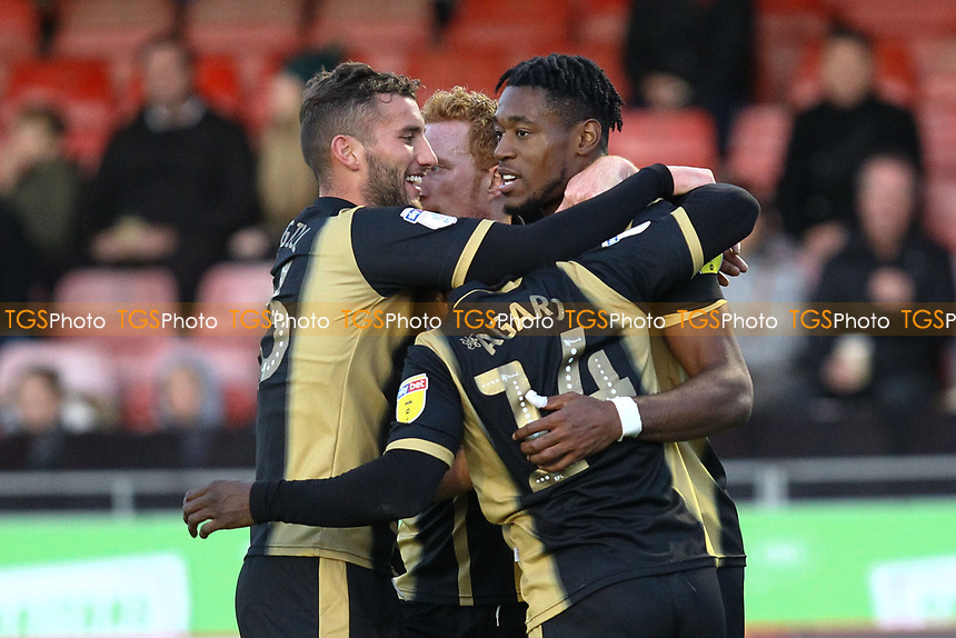 Chuks Aneke (right) of MK Dons celebrates his goal in the second half and the forth for his team during Crawley Town vs MK Dons, Sky Bet EFL League 2 Football at Broadfield Stadium on 3rd November 2018