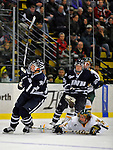 1 February 2008: University of New Hampshire Wildcats' forward James vanRiemsdyk, a Freshman from Middletown, NJ, is tripped up by University of Vermont Catamounts' forward Chris Atkinson, a Freshman from Sparta, NJ, at Gutterson Fieldhouse in Burlington, Vermont. The seventh-ranked Wildcats defeated the Catamounts 5-1in front of a sellout crowd of 4,003...Mandatory Photo Credit: Ed Wolfstein Photo